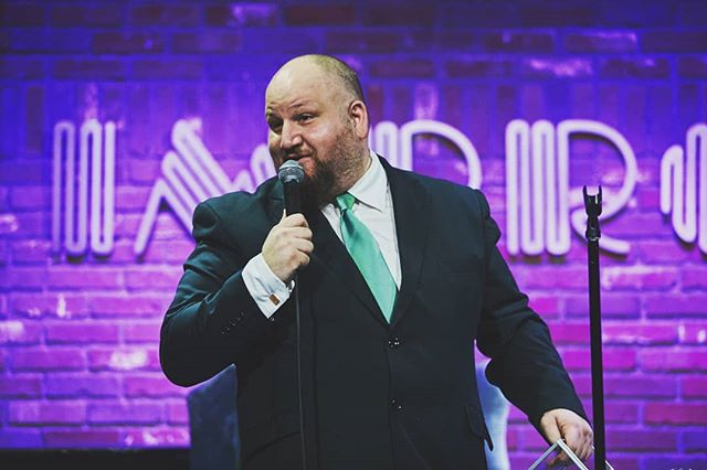 Stephen Kramer Glickman onstage at Hollywood Improv.