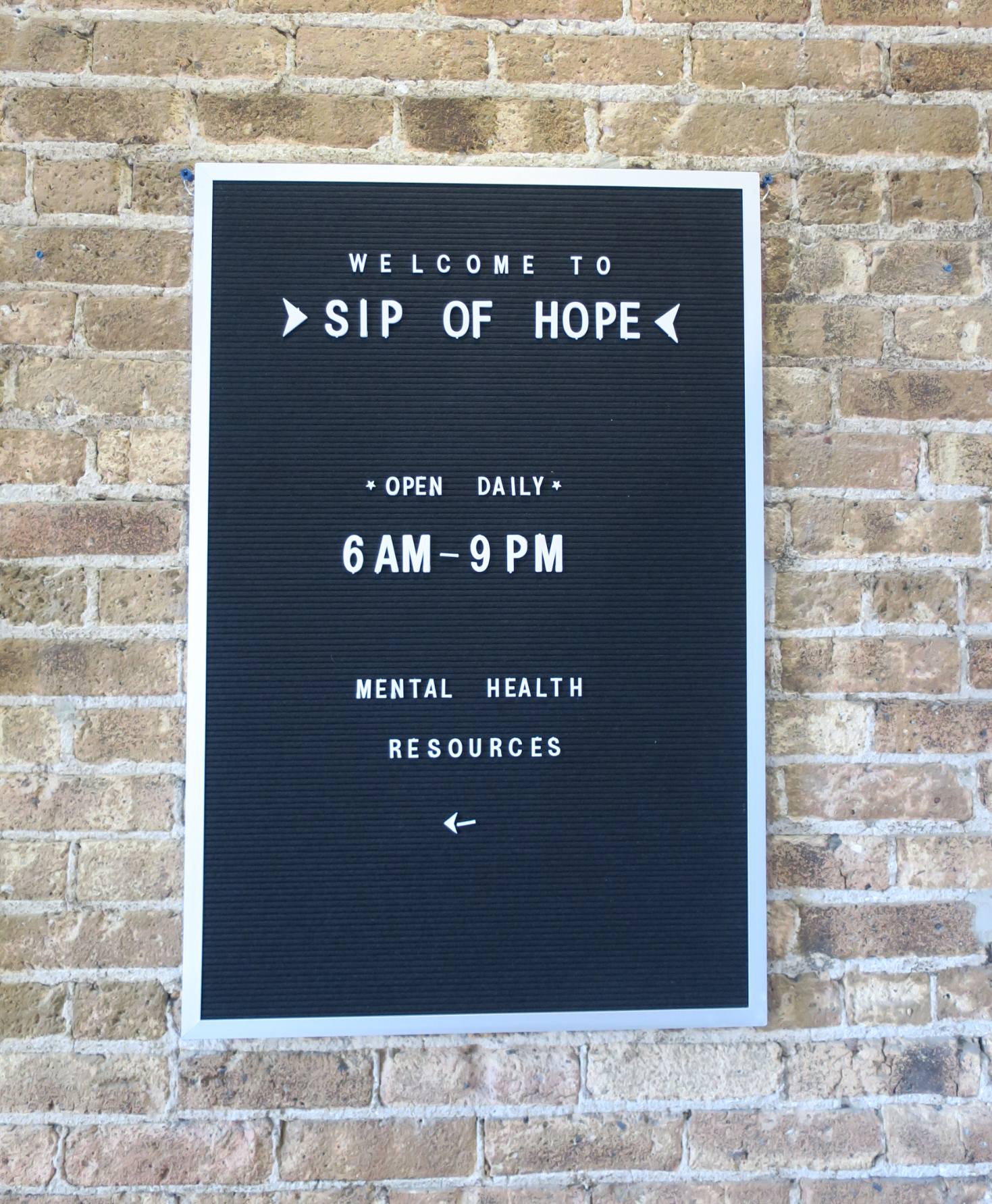 Sip of Hope - sign pointing to mental health awareness pamphlets and resources.