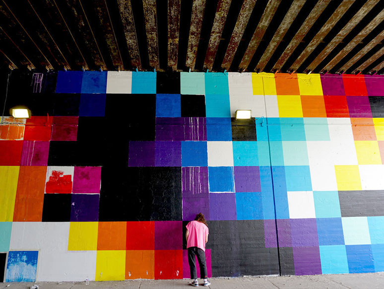 Felipe Pantone painting a mural on the B_Line in Chicago