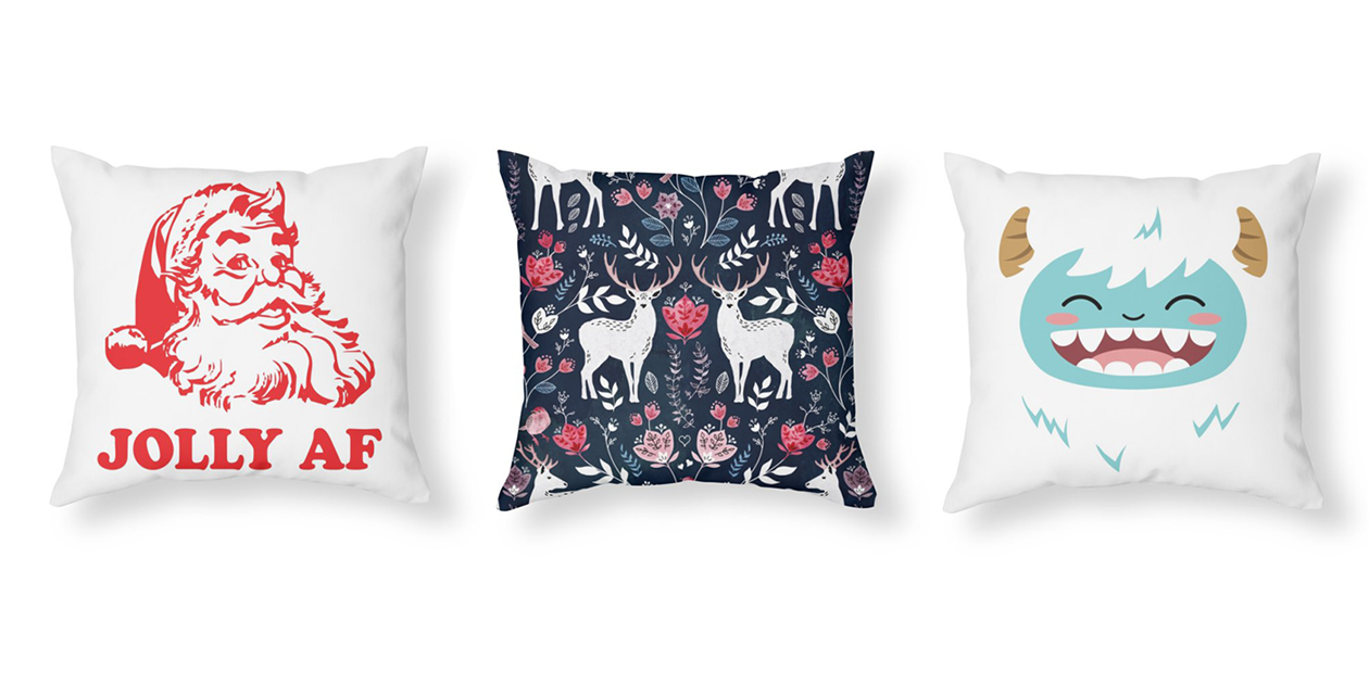 """""""Jolly AF"""" Throw Pillow by 3bagsfulltees, """"Scandinavian Deer"""" Throw Pillow by AdenaJ, and """"Happy Yeti"""" Throw Pillow by JCLovely"""