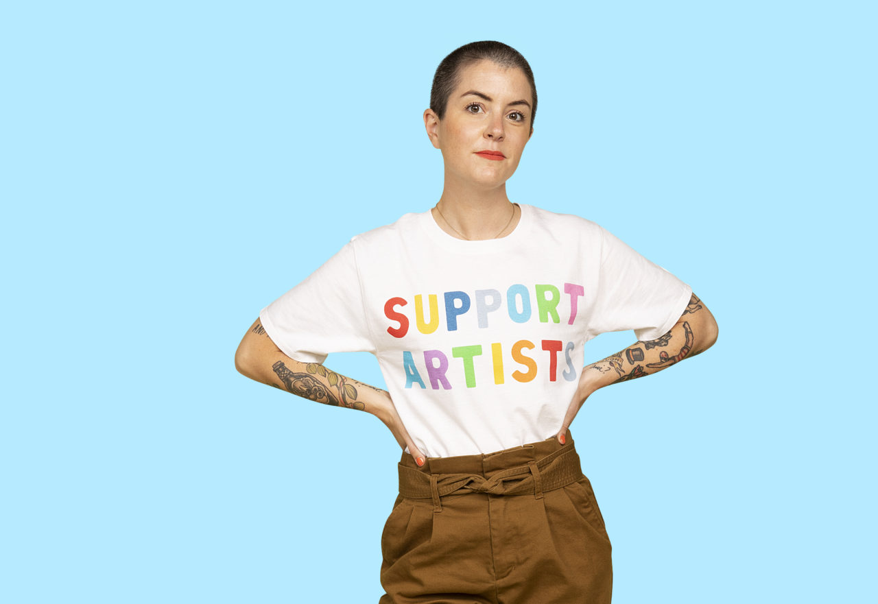 "Whitney LaMora wearing EmelineTate's ""Support Artists"" Champion® T-Shirt"